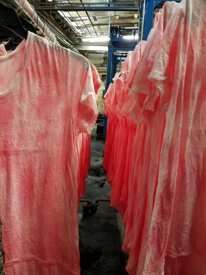 Photo of process finishing line with hanging clothing