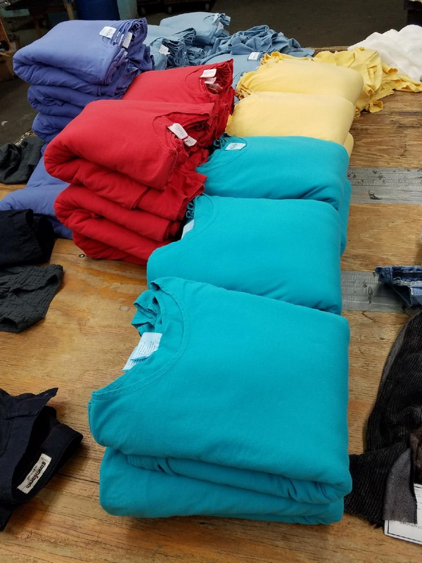 Photo of stacked and folded shirts showing available samples